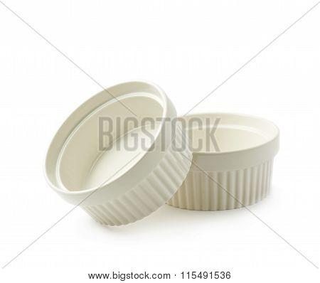 Porcelain souffle ramekin dishes isolated