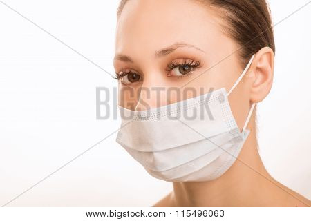 Young girl is wearing sterile face mask.