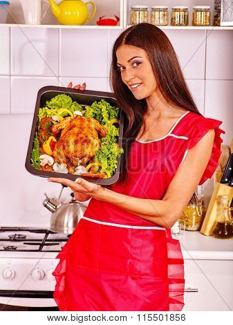 Happy young women cooking chicken with vagetable at kitchen.