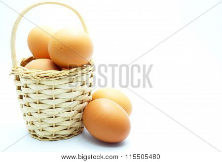 Eggs in wooden basket. Focus on eggs in basket. Space for texts.