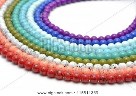 Rainbow chaplet - multicolored glass and natural beads strung on thread poster