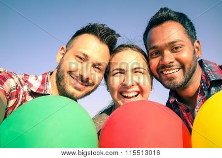 Friends Holding Colorful Balloons Enjoing Taking A Selfie