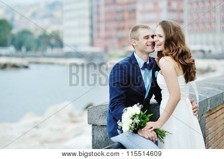 Happy Smiling Couple Bride And Groom In Wedding Day In Naples, Italy