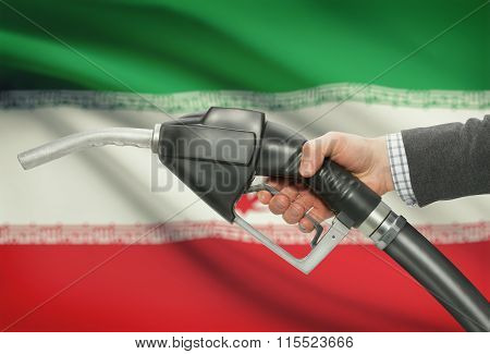 Fuel Pump Nozzle In Hand With National Flag On Background - Iran
