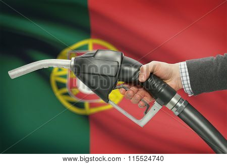 Fuel Pump Nozzle In Hand With National Flag On Background - Portugal