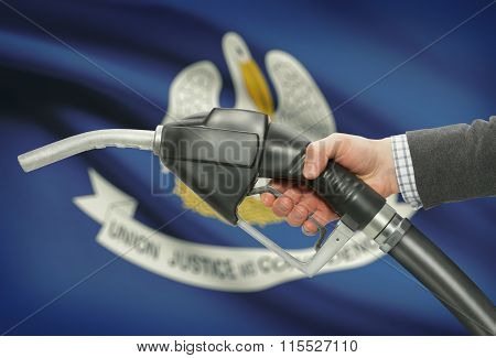 Fuel Pump Nozzle In Hand With Usa States Flags On Background - Louisiana