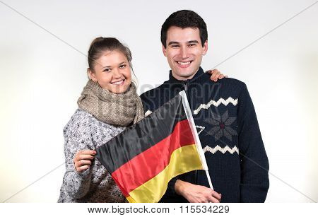 Couple Holding German Flag