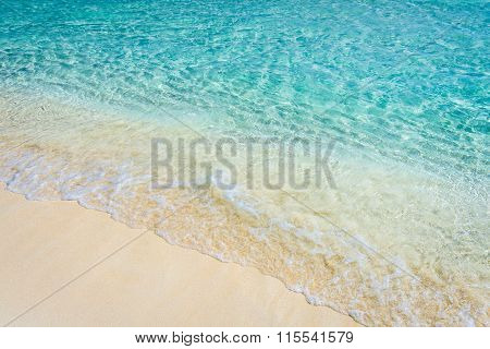 Soft Wave Of The Tropical Sea On The Sandy Beach