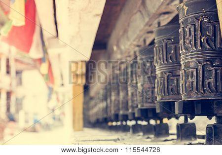 Closeup of Tibetan praying wheels.