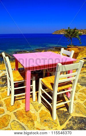 Traditional Greek Tavern On The Beach Of Mediterranean Sea