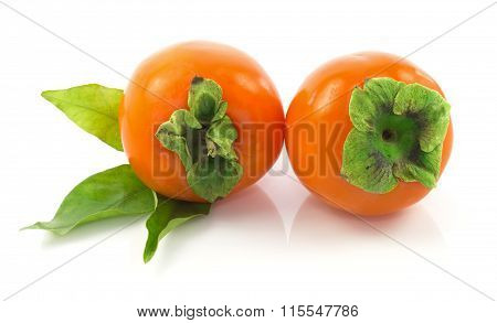 Ripe Whole Persimmons With Fresh Leaves