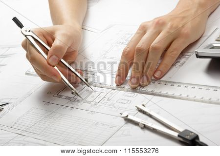 Architect working on blueprint. Architects workplace - architectural project, blueprints, ruler, calculator, laptop and divider compass. Construction concept. Engineering tools. poster