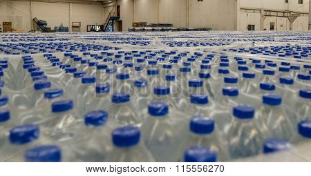 Thousands of water bottles are stored in warehouse