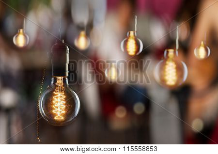 Vintage Incandescent Edison Type Bulbs And Window Reflections