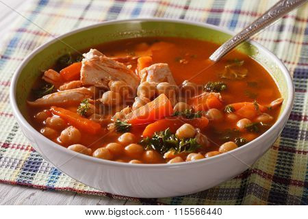 Tomato Soup With Chickpeas And Chicken Close-up. Horizontal