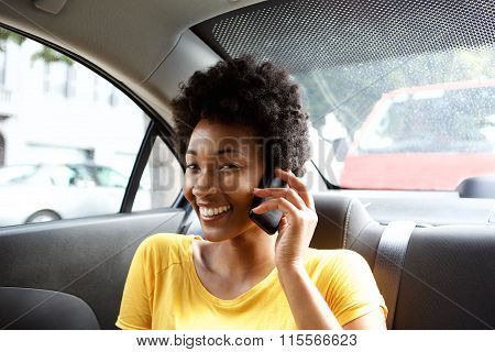 African Woman In A Car Talking On Mobile Phone