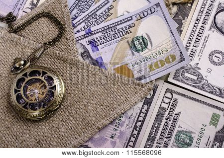 Banknotes Hundred Dollars And Other Denomination, Burlap And Pocket Watches.