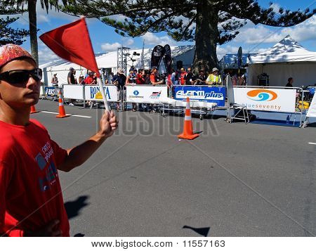 Red flag waved to slow approaching contestants.