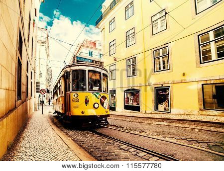 Lisbon, Portugal - January 20, 2016: Famous Old Yellow Tram On Romantic Typical Street Of Lisbon.