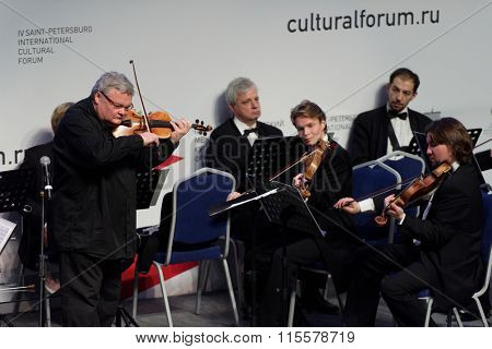 ST. PETERSBURG, RUSSIA - DECEMBER 16, 2015: Violinist and conductor Sergey Stadler and the Symphony Orchestra of St. Petersburg play at the creative meeting during 4th St. Petersburg Cultural Forum