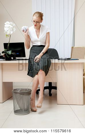 Yong Businesswoman Throwing Crumpled Paper Into A Wastepaper Basket.
