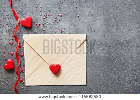 Blank present Valentine card with small hearts on grey textured background