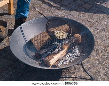Fire Pit With Burning Logs Making Popcorn