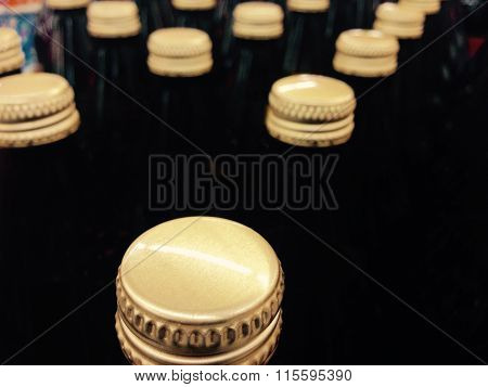Bottles Golden Caps Assorted In Lines