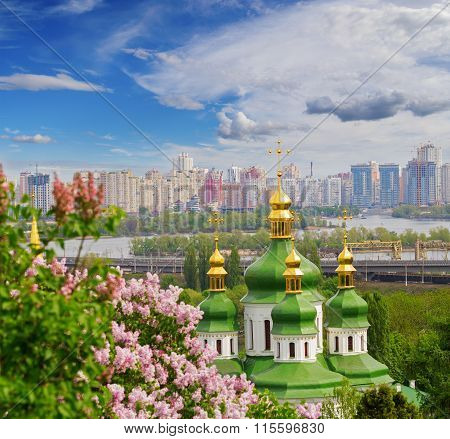 Beautiful view on the pink blossoms of lilac and Vydubychi monastery in botanic garden Kiev Ukraine
