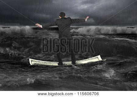 Businessman Standing Balancing On Money Boat Floating In Dark Ocean