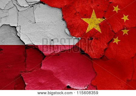 Flags Of Poland And China Painted On Cracked Wall