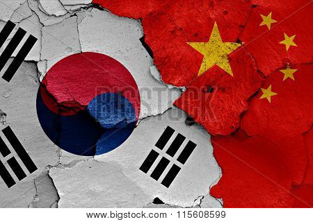 Flags Of South Korea And China Painted On Cracked Wall