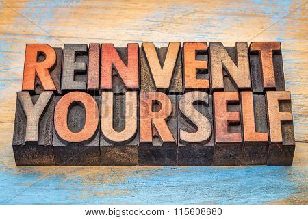 reinvent yourself - motivational words in vintage letterpress wood type blocks stained by color inks