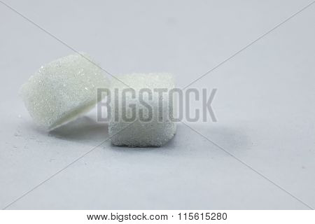 Sugar Cubes on Isolated White Background with Harsh Shadow which can be used to imply dark side of S