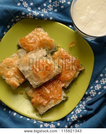 tasty spinach pie on a green dish