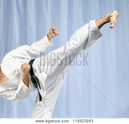 With black belt athlete is beating blow leg