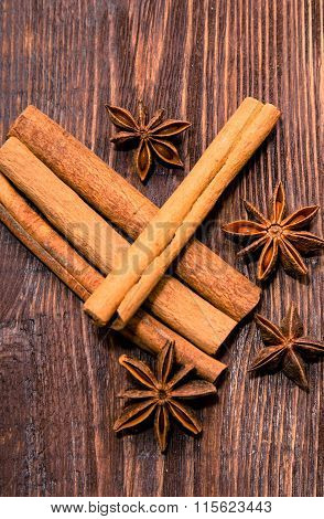 Cinnamone and anisetree on dark wooden background