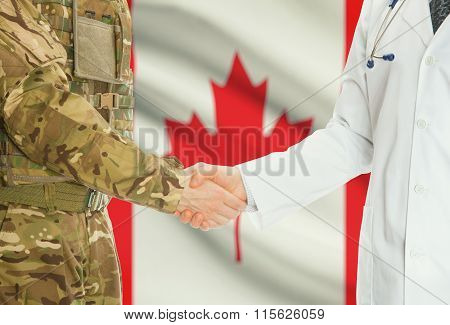 Military Man In Uniform And Doctor Shaking Hands With National Flag On Background - Canada