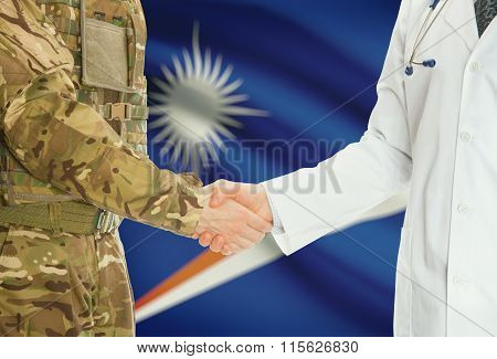 Military Man In Uniform And Doctor Shaking Hands With National Flag On Background - Marshall Islands