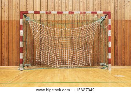 The soccer goal in an old multisport gymhall