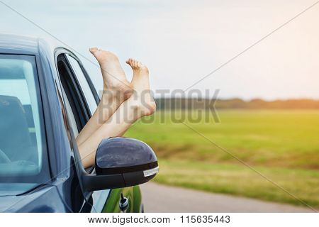 Womans Legs Out Of The Car Window