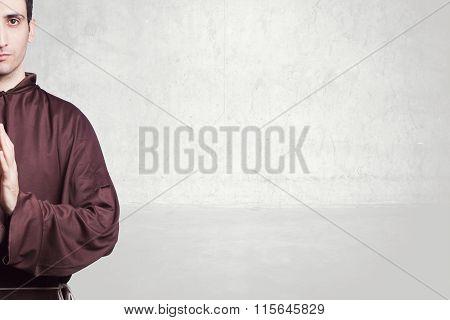 young friar praying