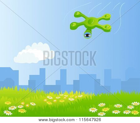 Funny quadrocopter flying over green field