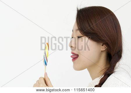 Young asian woman with a lollipop