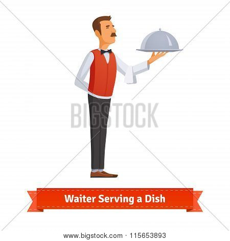 Waiter in a bow-tie serving dish on silver platter