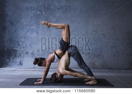 Man and woman practice yoga together