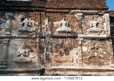 Ancient Thai Art On The Maha Chedi Of Wat Jhet Yot Temple In Chaing Mai,Thailand.
