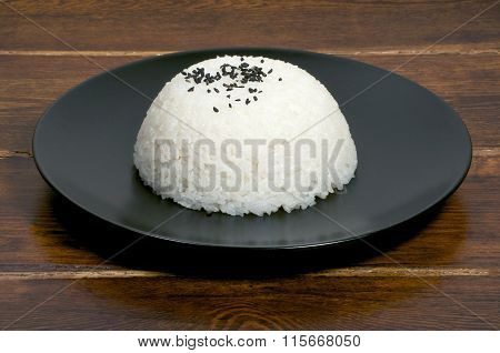 Portion Of Rice On The Plate Side View With Sesame Seeds