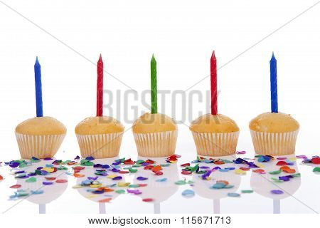 Birthday Cupcakes In A Row Over White Background