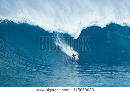 MAUI, HI - JANUARY 16 2016: Professional surfer Will Hunt rides a giant wave at the legendary big wave surf break known as
